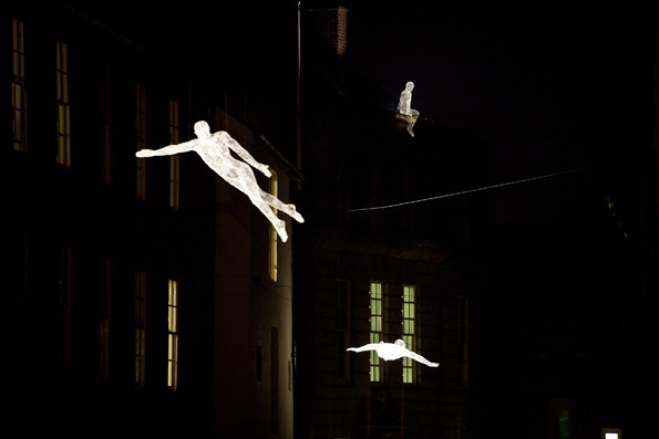 artist cdric le borgnes spectral light sculptures les voyageurs floated about inhabiting various parts of the city like guardians from another reality - Captivating Light Installation Artists