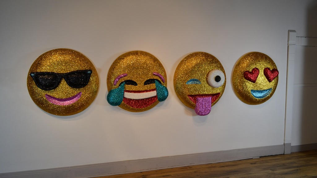 Emoji Wall Art glittering emojis replace censored bieber sculpture at