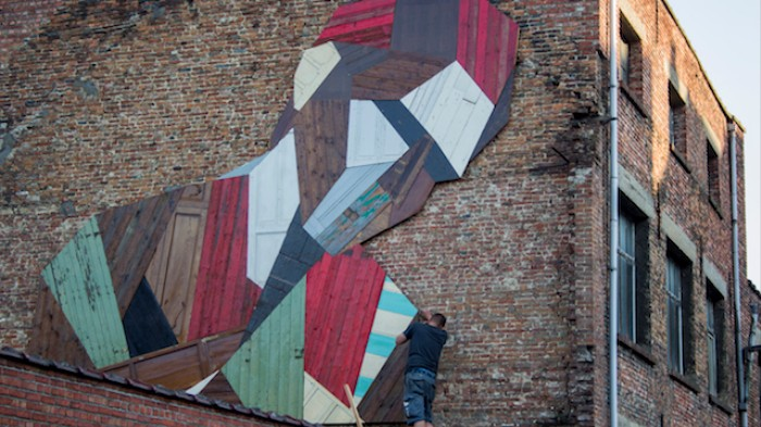 Europe's Upcycled Doors Become Giant Face Murals