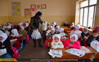 5_ISIS gives out school supplies.jpg