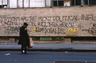 8. THESE INSTITUTIONS HAS THE MOST POLITICAL INFLUENCE A.TELEVISION B. THE CHURCH C. SAMO D. MC DONALDS'. Downtown 81, Edo Bertoglio ©New York Beat Film.png